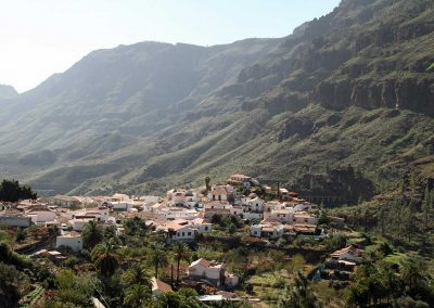 A village in a valley between mountains