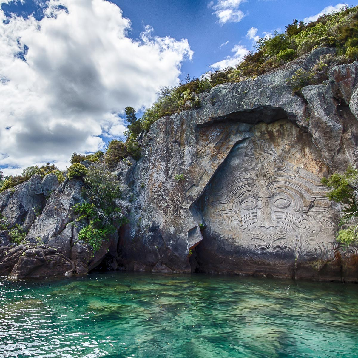 Maori mural at a lakeside in New Zealand