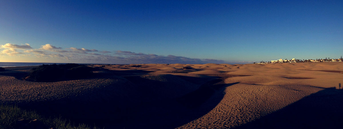 Mas Palomas Dunes with shadows and distant town