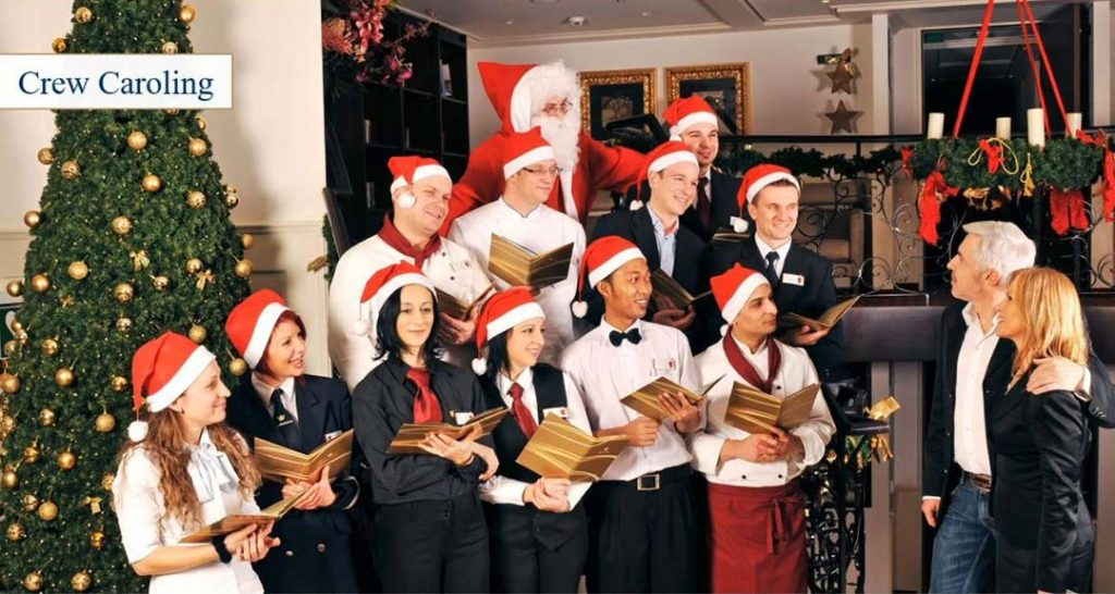 AmaWaterways crew greet passengers as they board the Christmas Markets Cruise