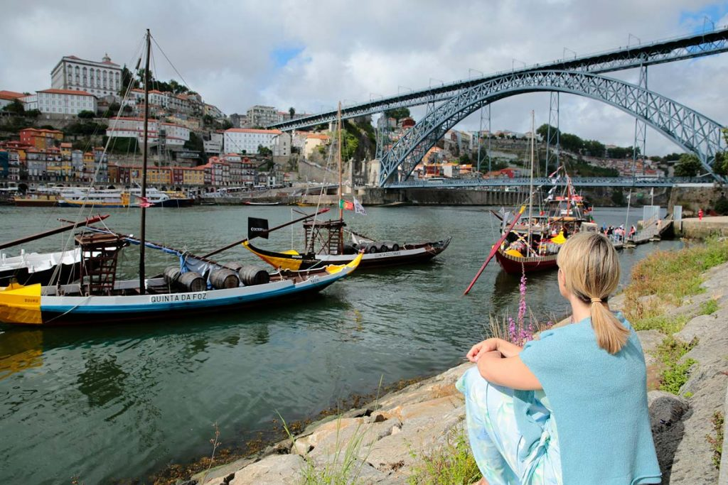 Woman watching boats in Porto during the Enticing Douro River-Cruise