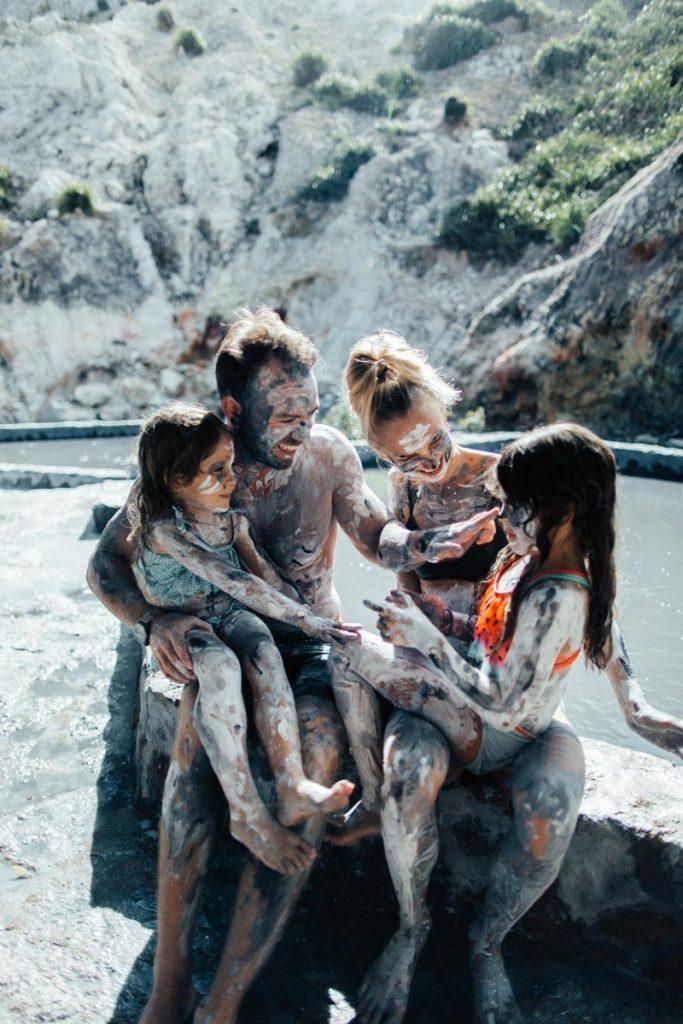 A family enjoy a mudbath at Soufriere's Sulphur Springs in Saint Lucia