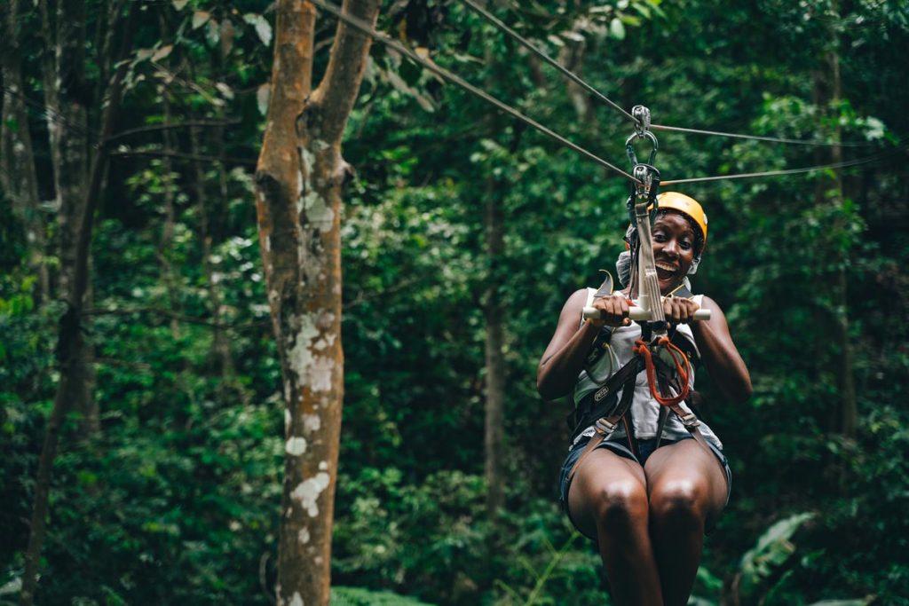 Female traveller ziplining through the Saint Lucia rainforest